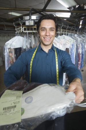Man working in the laundrette Stock Photo - 20741943