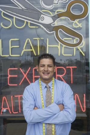 laundrette: Man standing infront of laundrette shop window LANG_EVOIMAGES