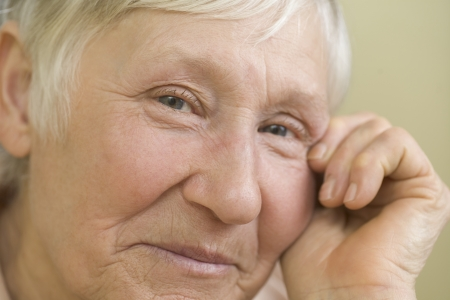 grey hair: Elderly woman with short grey hair  smiling LANG_EVOIMAGES
