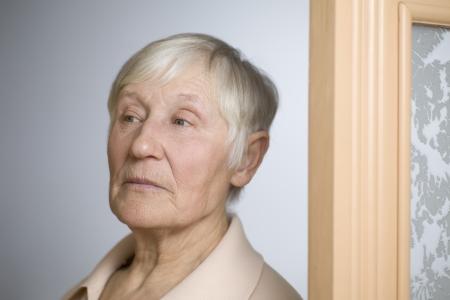 nosey: Elderly woman with short grey hair in doorway