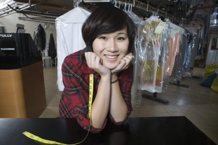laundrette: Happy woman working in the laundrette