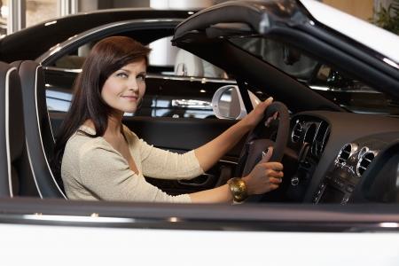 test drive: Woman having a test drive LANG_EVOIMAGES