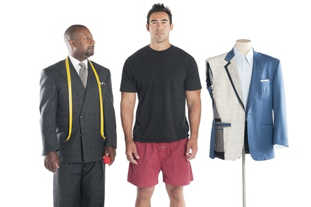 customer tailor: Tailor standing with his customer LANG_EVOIMAGES