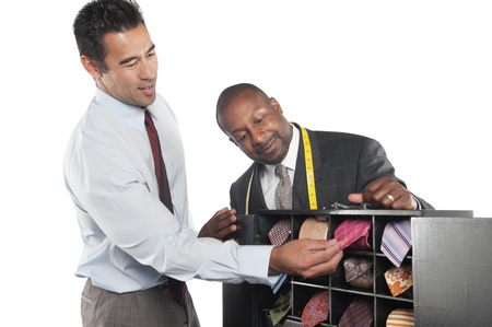 decisionmaking: Man selecting neckties with tailor standing besides