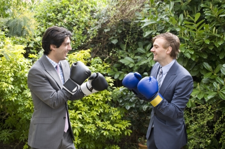 peo: Two young men in suits stage a mock boxing match LANG_EVOIMAGES