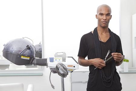 hairstylist: Portrait of African male hairdresser