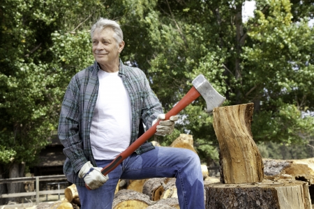 occ: Senior lumber jack holding an axe and looking away LANG_EVOIMAGES