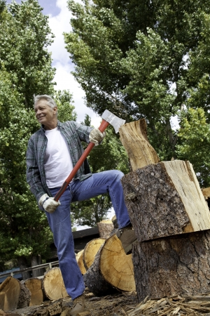 occ: Low angle view of man holding an axe