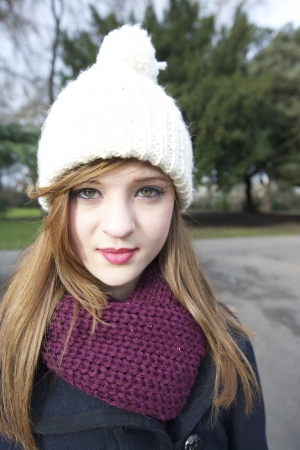 knit cap: Portrait of beautiful young woman wearing scarf and knit cap LANG_EVOIMAGES