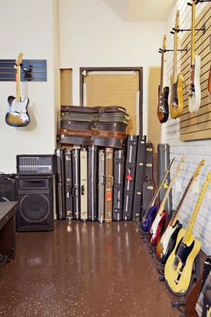 musical instrument: Electric guitars with guitar cases and amplifier in store