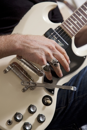 ins: Close-up of mans hand playing electric guitar
