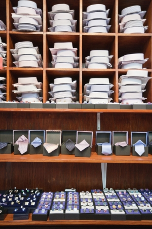 cuff links: Shirts,neckties and hand cuff links displayed on shelves LANG_EVOIMAGES
