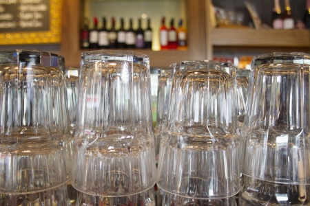 upturned: Upturned glasses at a pub counter