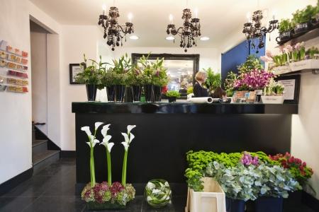 flower shop: Woman working in florist shop