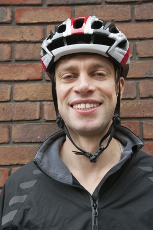 crash helmet: Portrait of happy biker wearing crash helmet