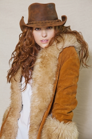 pers: Portrait of beautiful long haired cowgirl