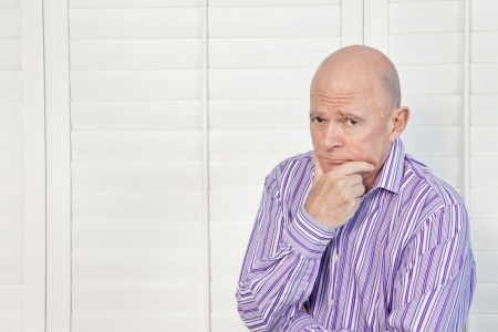 Senior man in pensive mood with hand on chin Stock Photo - 20743125