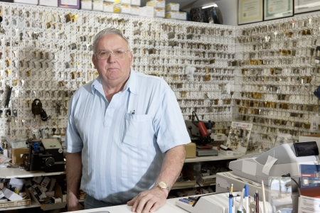 locksmith: Portrait of locksmith in store LANG_EVOIMAGES