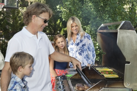 barbecuing: Family of four barbecuing