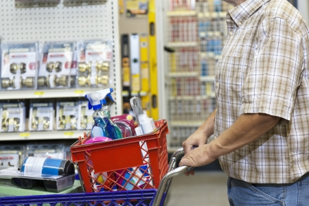 hardware: Midsection of man with shopping cart in hardware store