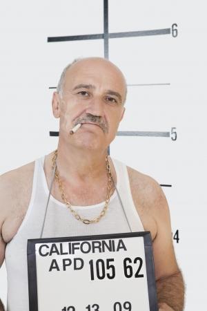 identifying: Mug shot of senior gangster smoking cigarette