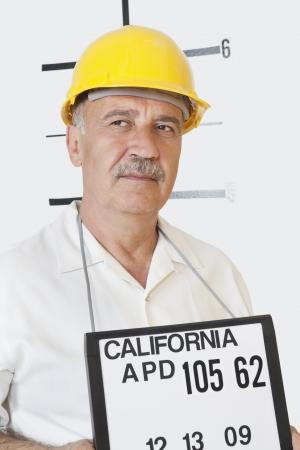 english ethnicity: Mug shot of senior male constructor looking away LANG_EVOIMAGES