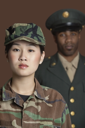 army soldier: Portrait of young female US Marine Corps soldier with officer in the background LANG_EVOIMAGES