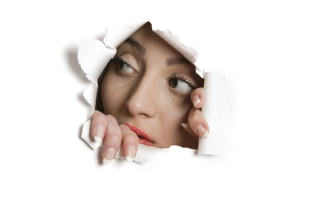 Young Middle eastern woman looking away from ripped paper hole Stock Photo - 20767445