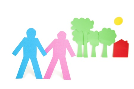 gro: Paper cut outs representing a couple with trees and house over white background