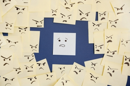 accuser: Sticky notes with anthropomorphic face blaming colleague LANG_EVOIMAGES