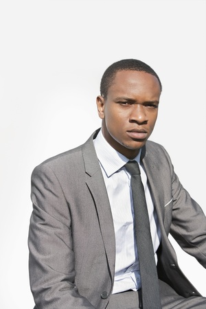 occ: Portrait of a serious African American businessman over white background