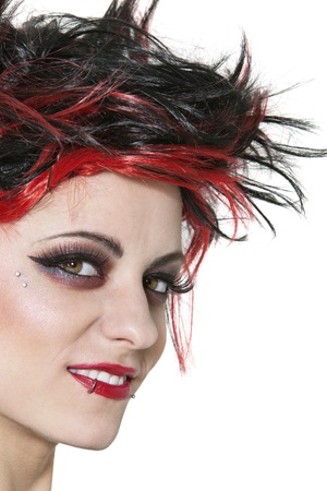 nonconformity: Close-up of beautiful punk woman smiling over white background LANG_EVOIMAGES