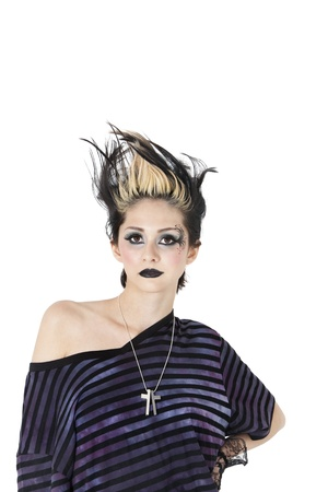 spiked hair: Portrait of a gothic woman with spiked hair over white background LANG_EVOIMAGES