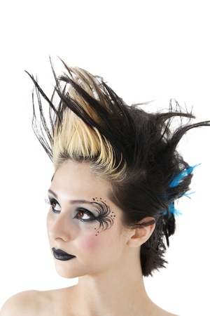 spiked hair: Close-up of gothic woman with face painting and spiked hair over white background LANG_EVOIMAGES