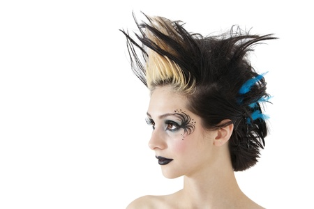 spiked hair: Close-up of beautiful gothic woman with spiked hair and face painting over white background