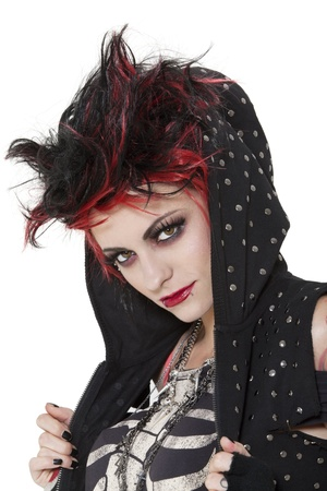 nonconformity: Close-up portrait of young punk woman wearing hood over white background LANG_EVOIMAGES