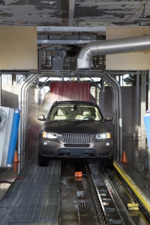 Motor vehicle passing through car wash Stock Photo - 20768027