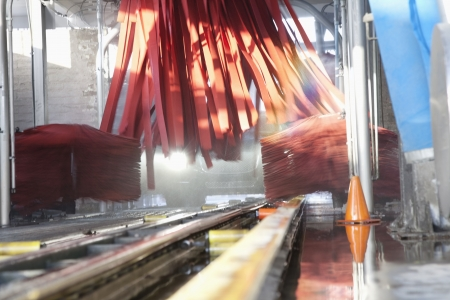 Vehicle moving on conveyor going through cleaning in car wash Stock Photo - 20768029