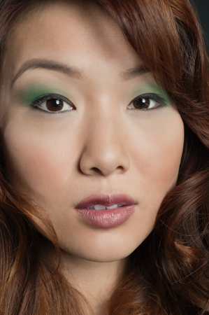 peo: Close-up portrait of beautiful Chinese woman LANG_EVOIMAGES