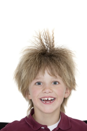 spiked hair: Close-up portrait of a cheerful school boy with spiked hair over colored background