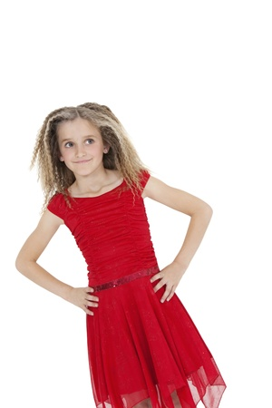 peo: Tilt image of girl in red frock with hands on hips over white background LANG_EVOIMAGES