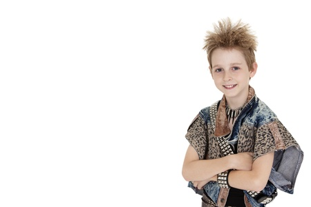 Portrait of pre-teen boy standing with arms crossed over white background Stock fotó