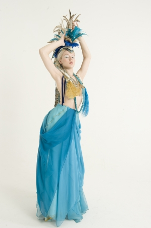 peo: Attractive young woman wearing costume posing over colored background