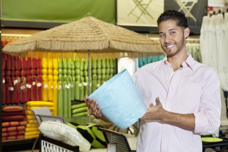 Happy young man holding a souvenir in store Stock Photo - 20768550