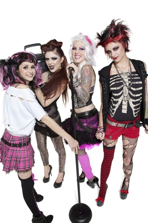 peo: Portrait of young rock band of females with microphone and boom box over white background LANG_EVOIMAGES