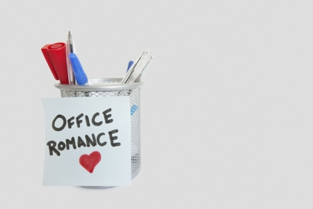 office romance: Conceptual image of sticky notepaper with heart shape depicting office romance