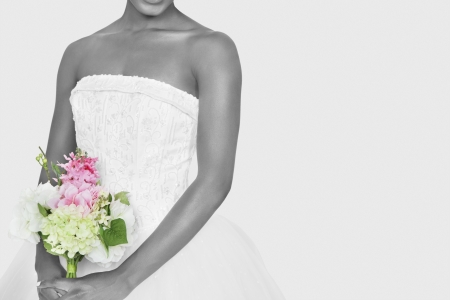 Midsection of bride holding bouquet over gray background Stock Photo - 20768887