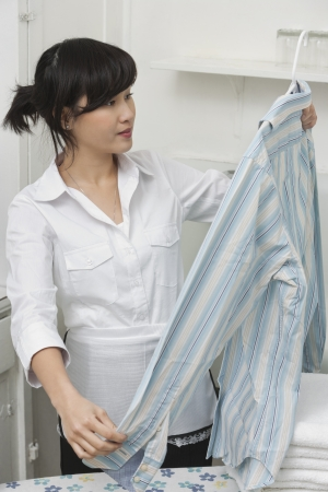 oc: Female housekeeper looking at shirt