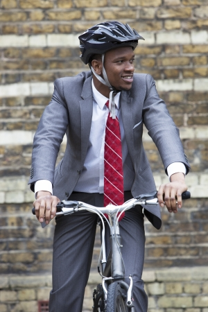 occ: Portrait of African American businessman riding Bicycle