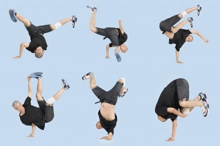Multiple image of young man break dancing over light blue background Stok Fotoğraf